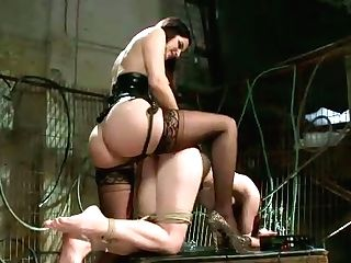 Electrical Mistress Fucks Crimson Haired Chick In Rear End Pose On A Torment Table